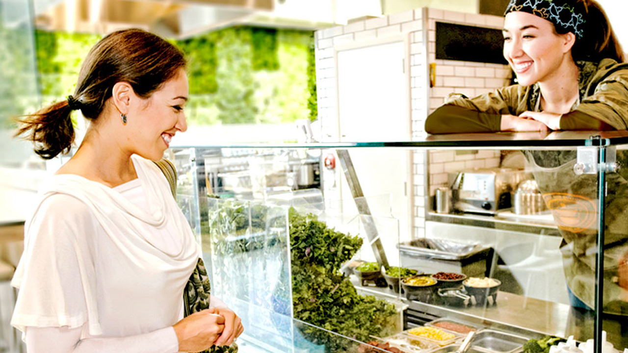 A woman looking at the salad bar; image used for HSBC Malaysia Cash Instalment Plan page