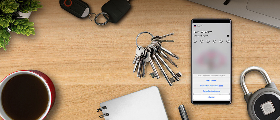 Lock, keys and mobile phone with HSBC Malaysia app on screen; image used for HSBC Malaysia Mobile Secure Key
