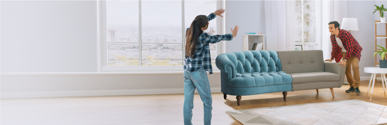 Couple moving couch; image used for HSBC card instalment plan mastercard page.