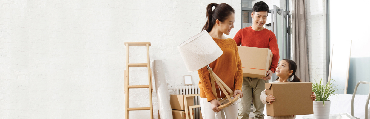 A couple is moving the sofa in living room; image used for HSBC Malaysia card instalment plan page.