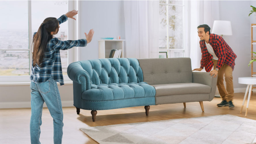 Couple moving couch; image used for HSBC Mastercard Instalment Promotion page.