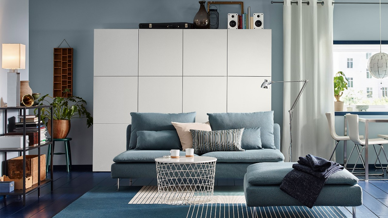 A cabinet, a bed, a tea table, and a sofa; image used for IKEA promotion page.