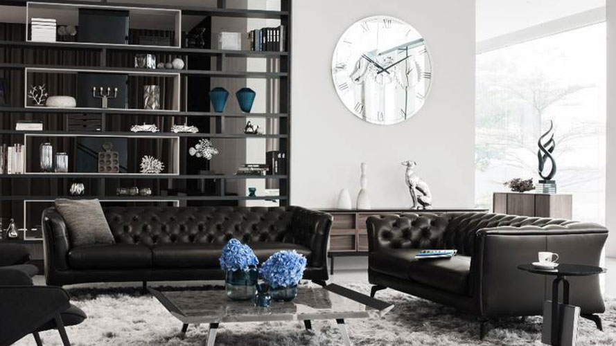 A cabinet, a clock, two sofas, and a tea table; image used for Rozel promotion page.