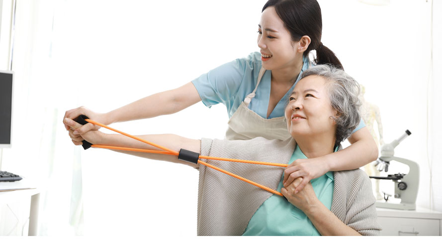 Woman doing stretching exercises with elderly woman; image used for HSBC Malaysia insurance and Touch 'n Go campaign