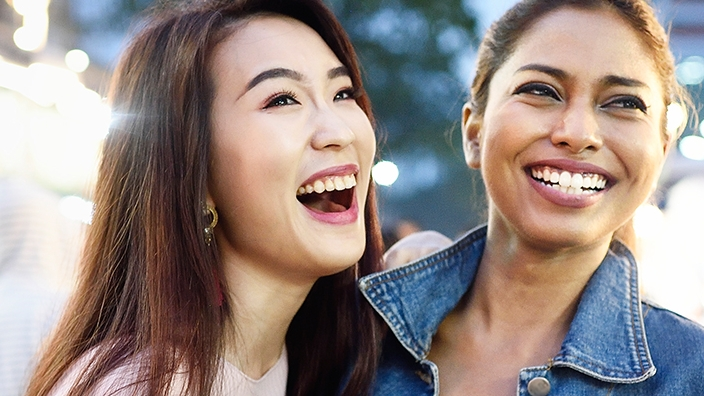 Two women smiling; image used for HSBC Malaysia Great ways to use cash article
