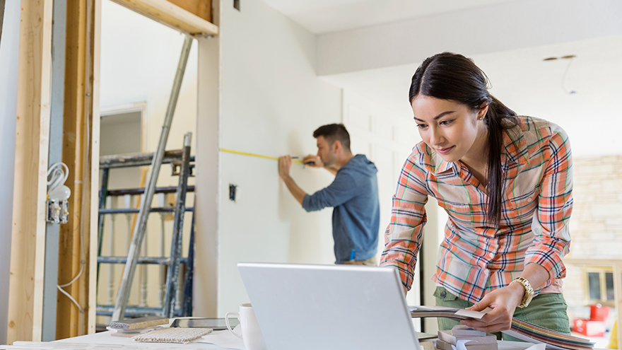 A woman and a man are fixing a house; image used for HSBC Malaysia How to Spend Money Wisely article