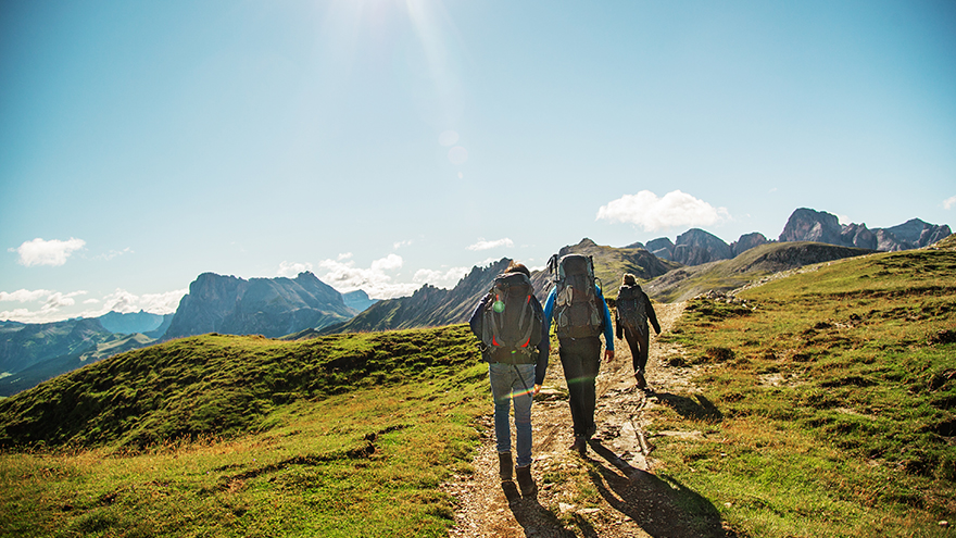 Three people are hiking; image used for HSBC Malaysia How to Spend Money Wisely article
