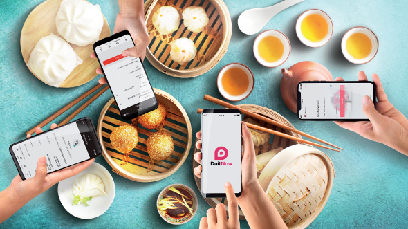 Four people taking pictures of food; image used for HSBC Malaysia Samsung Note 9 offer