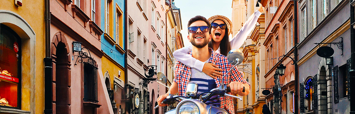 A happy couple is riding a motorcycle; image used for HSBC Malaysia zero interest instalment offer