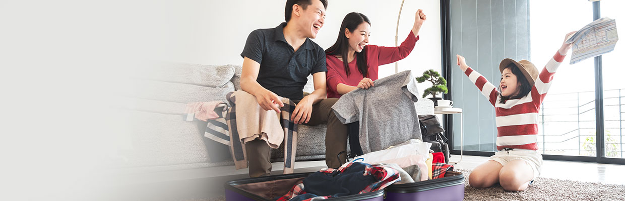 A family are packing a suitcase; image used for HSBC Malaysia Luggage Acquisition offer