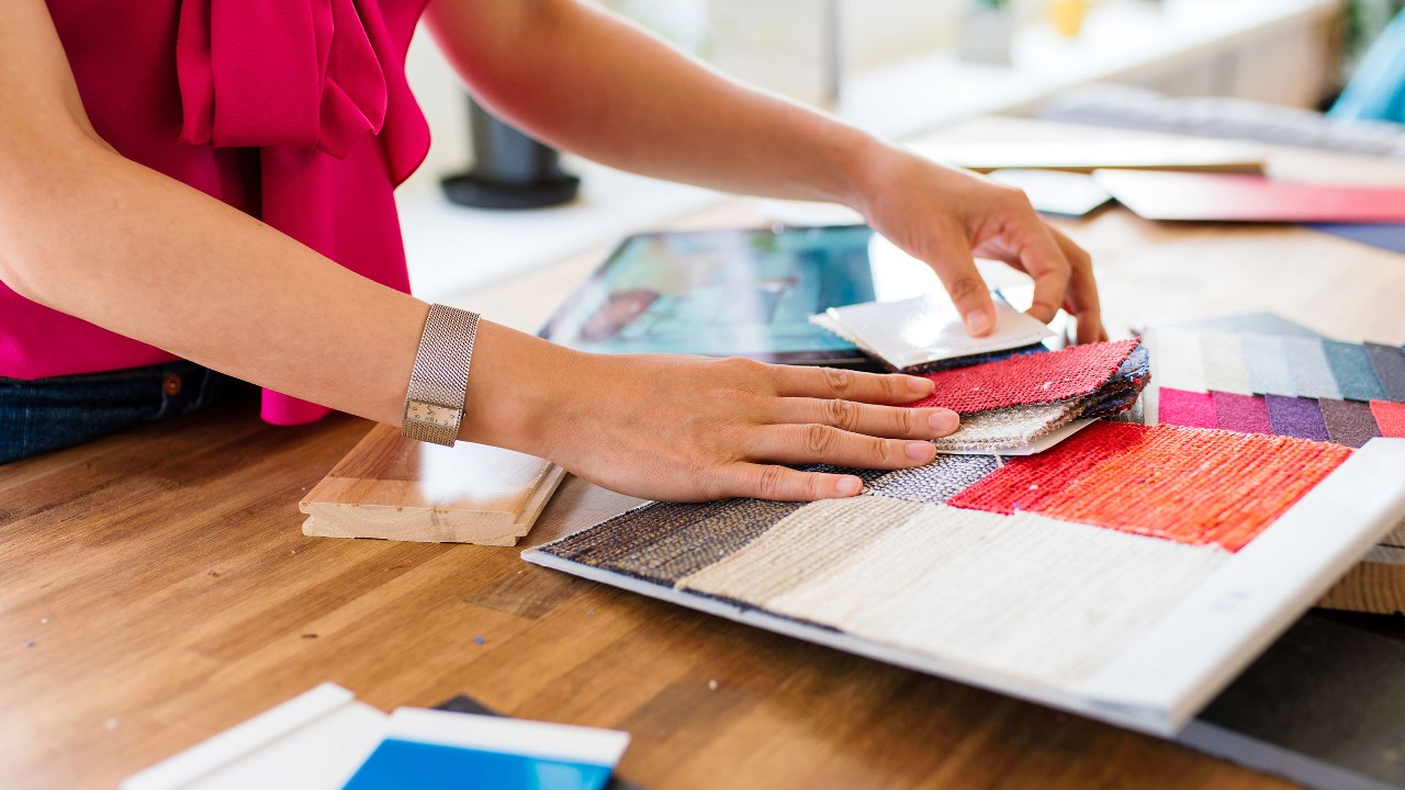 Small business owner checking the fabric in the shop; image used for HSBC Fusion Malaysia Products and services page