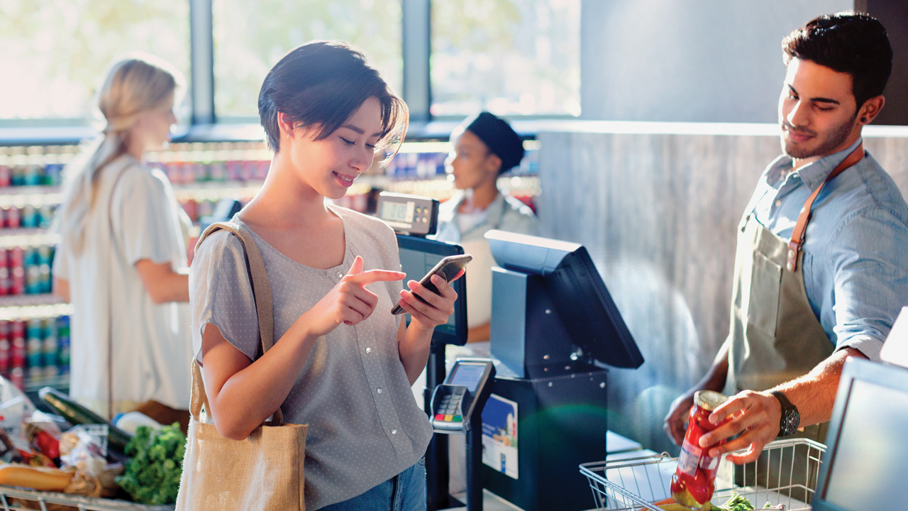 A woman shopping in the grocery store; image used for HSBC Fusion Basic Current Account.
