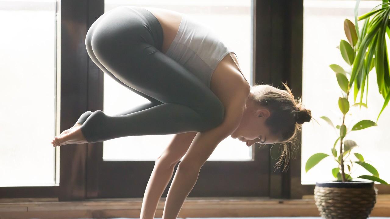 A yoga teacher is teaching yoga; image used for HSBC Fusion Malaysia 1-Biz Account page