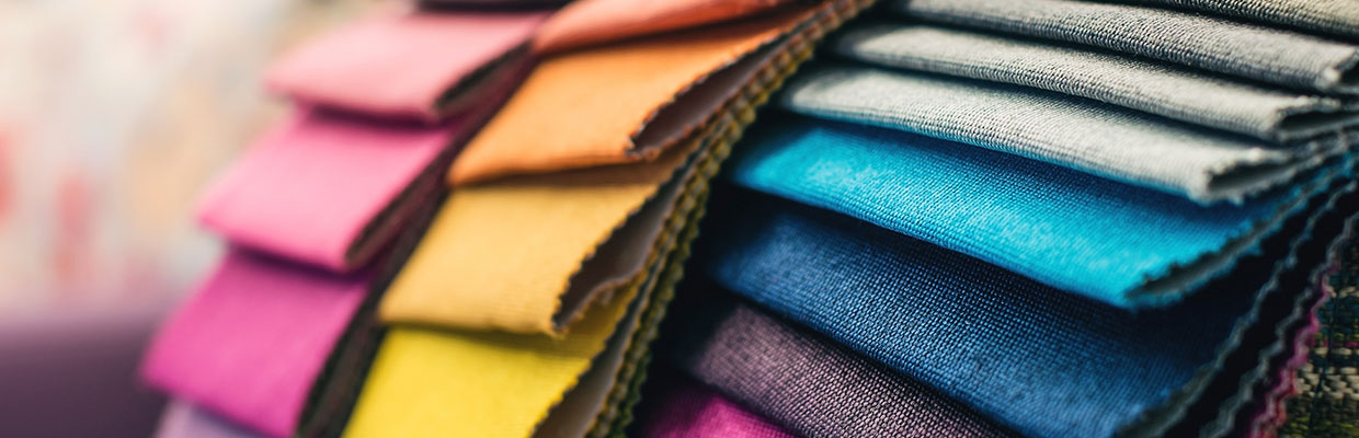 Colorful cotton fabric in the clothes shop; image used for HSBC Fusion Malaysia Products and services page
